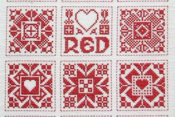 Red and white cross stitch sampler